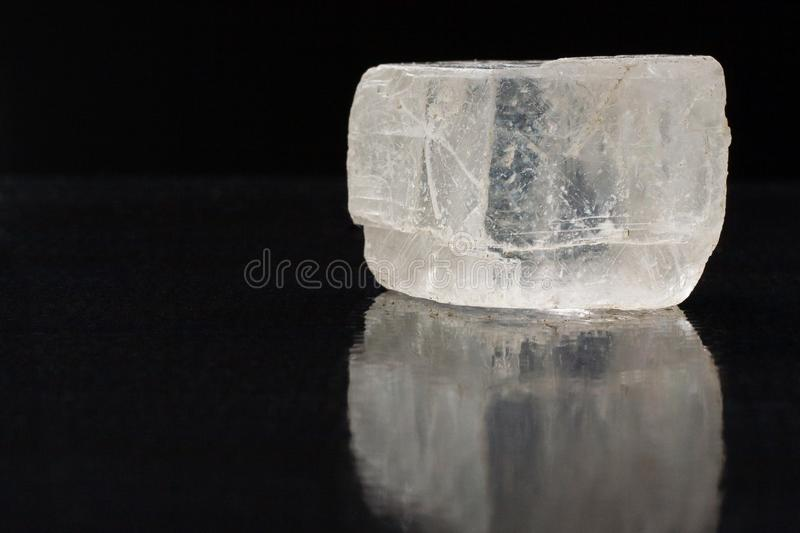 Iceland spar mineral displaying its optic properties on black background with reflection stock photos