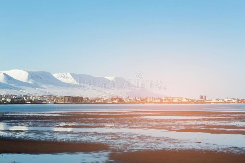 Iceland village winter season with mountain background stock images
