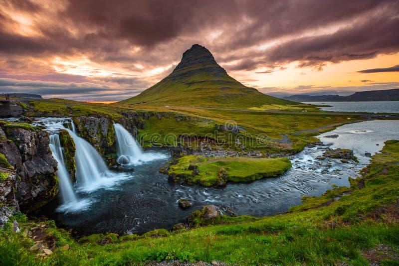 Iceland waterfall and famous mountain. Kirkjufellsfoss and Kirkjufell nature royalty free stock photography