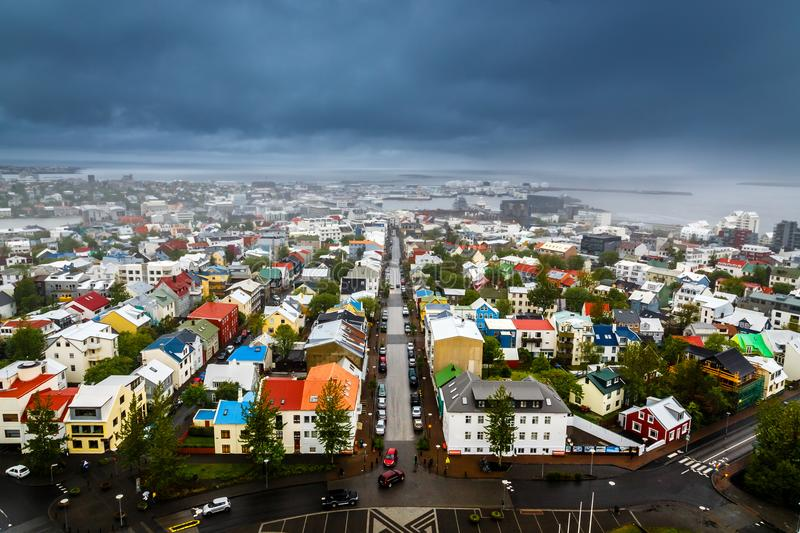 Icelandic capital panorama, streets and colorful resedential buildings with fjord and mountains in the background, Reykjavik, Ice royalty free stock image