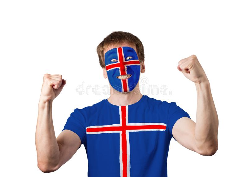 Icelandic fan with a painted face and a t-shirt rejoices. Isolate. White man. Studio shooting stock photography