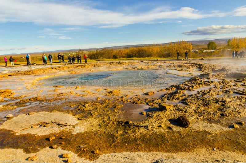 Iceland, September 27, 2019, a group of people watching a geyser, Icelandic Geyser Strokkur. Great tourist attraction on Golgen Ci. Icelandic Geyser Strokkur stock images