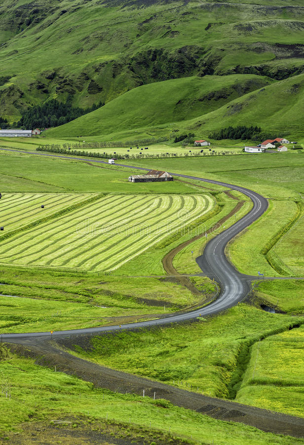 Icelandic mountain landscapes with asphalt road royalty free stock photo