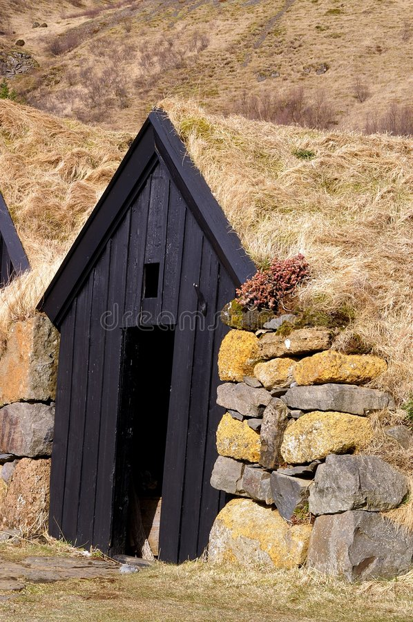 Icelandic Sod House. Antique turf bermed winter shelter royalty free stock photos
