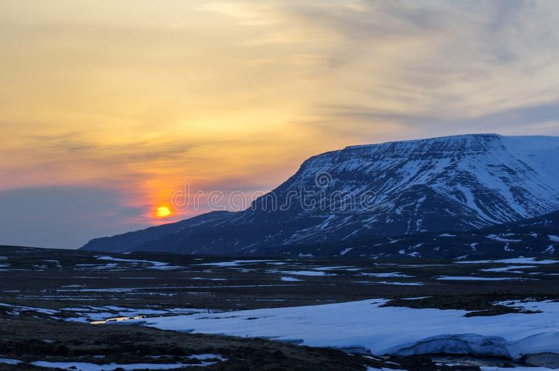 Icelandic Sunset over the mountains. Very much one of the main tourist attractions and points of interest in the area royalty free stock photos