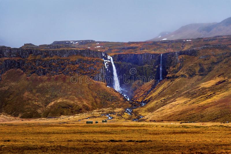 Icelandic waterfall in the mountains royalty free stock image