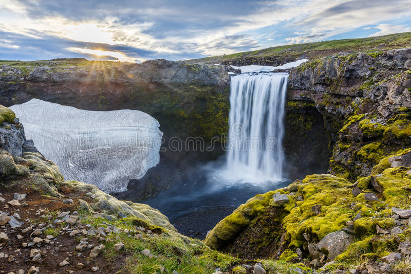 Icelandic waterfall. Sunsice above the glacier and waterfall at Iceland royalty free stock photo