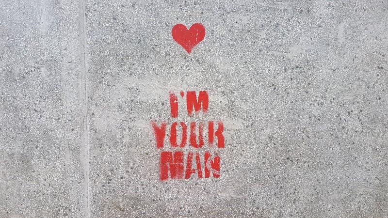 Ich bin Ihr Mann druckte rote Buchstaben und Hirsch in Asphalt Wallpaper Backgroung Texture Pattern lizenzfreie stockbilder
