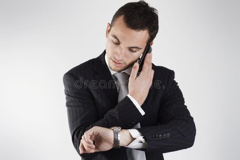 Ich rufe Sie später um? Uhr an stockbild