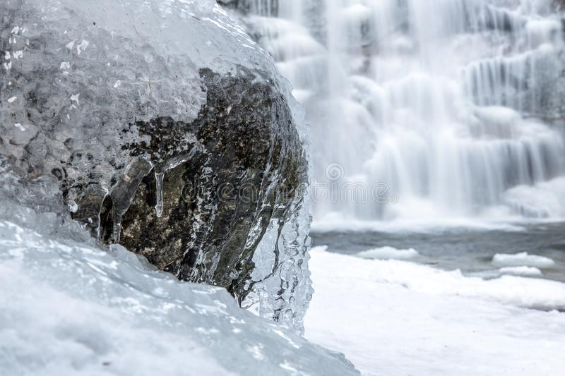 The water stream is froze on the stone royalty free stock photo