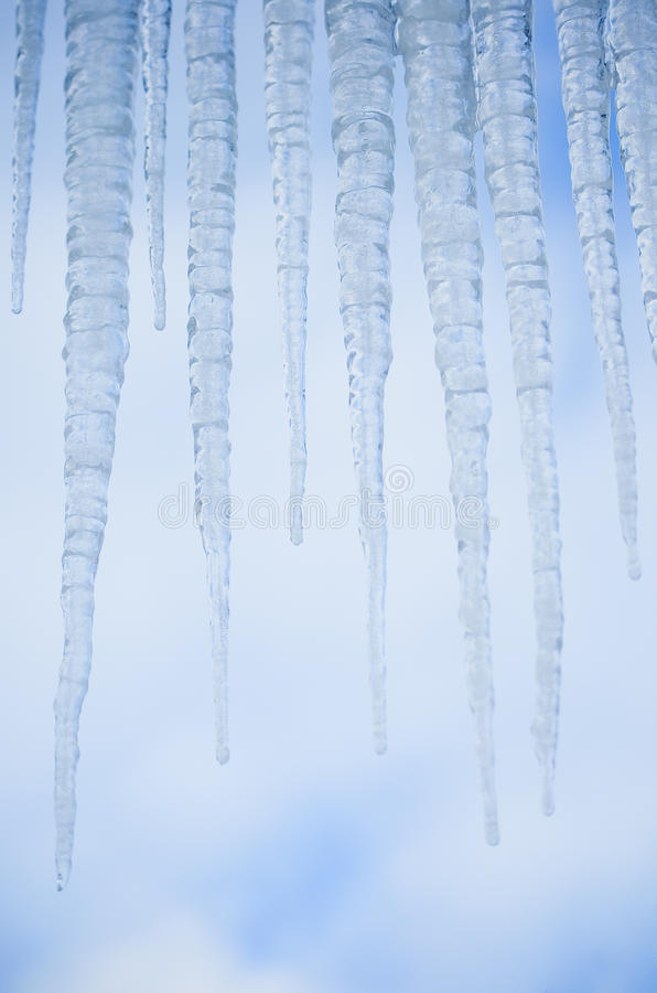 Icicles Against Blue Sky Stock Images