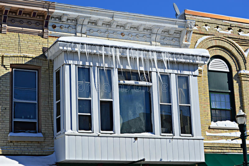 Icicles on Building. Icicles dangling on an old building in downtown Burlington, Wisconsin. Racine County - United States of America stock images