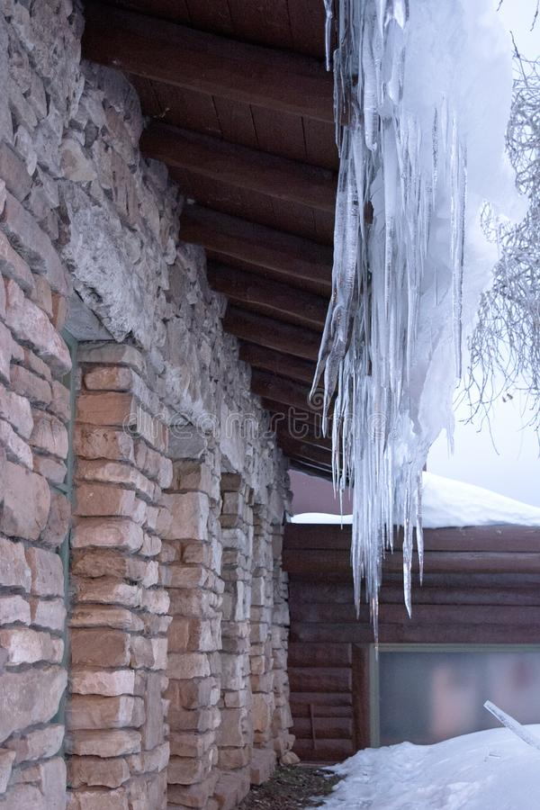 Icicles Dripping Off the Roof of Building in Northern Arizona During the Winter stock photos