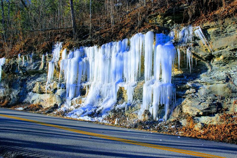 Icicles hang from the rocks along the road passing through Red River Gorge royalty free stock photo