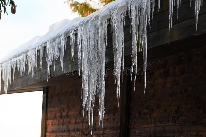 Icicles hanging from barn roof in South Germany. royalty free stock images