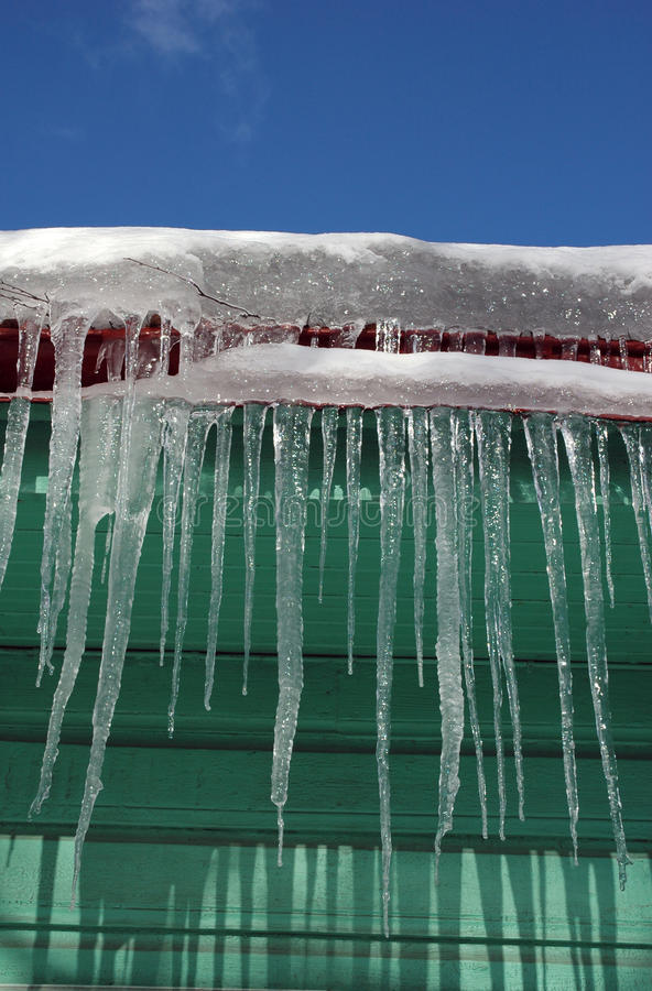Icicles Hanging From Roof Royalty Free Stock Image