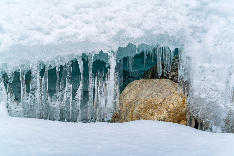 Icicles at ice cave in Frozen Lake Baikal stock photography