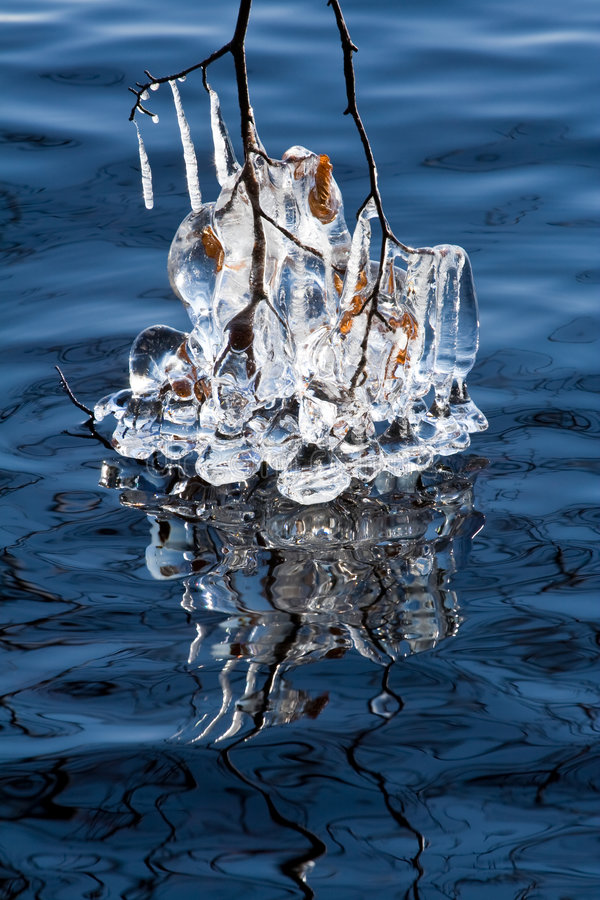 Icicles on a lake. Very special icicles were built on Helga lake in Sweden in March 2008 when a stormy wind was accompanied by a very cold weather. Every straw stock photo