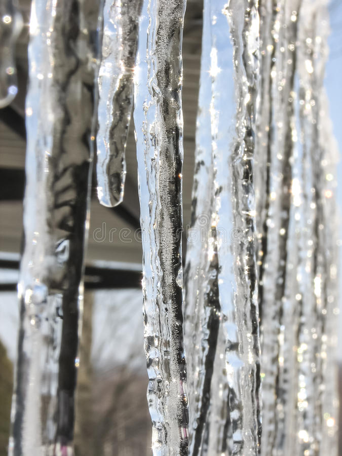 Icicles. Lit by soft light of the rising sun stock images