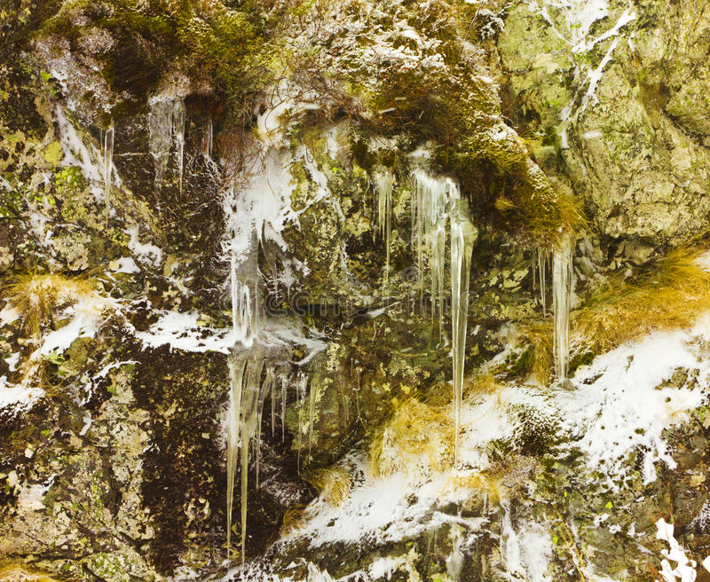 Icicles and rocks royalty free stock photography