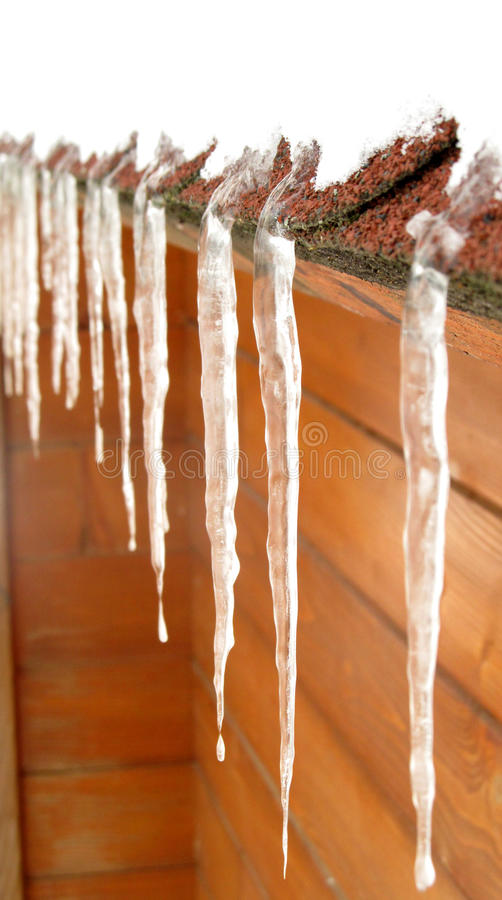 Icicles on a roof stock photos