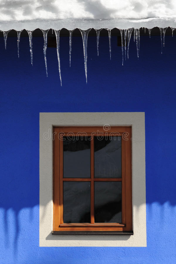 Icicles on the roof of Alpine Hut in Dolomites, Trentino, Italy stock images