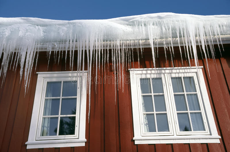 Icicles at a roof stock image