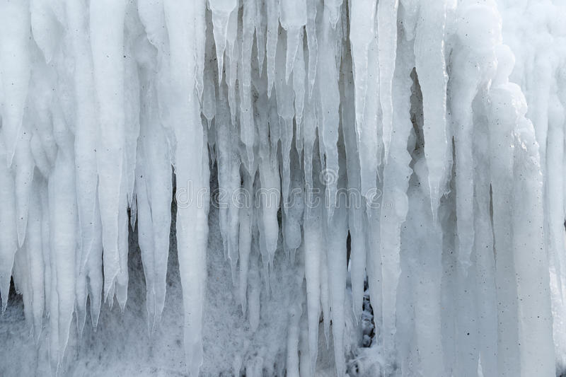 Icicles sparkling white ice hanging down royalty free stock photography