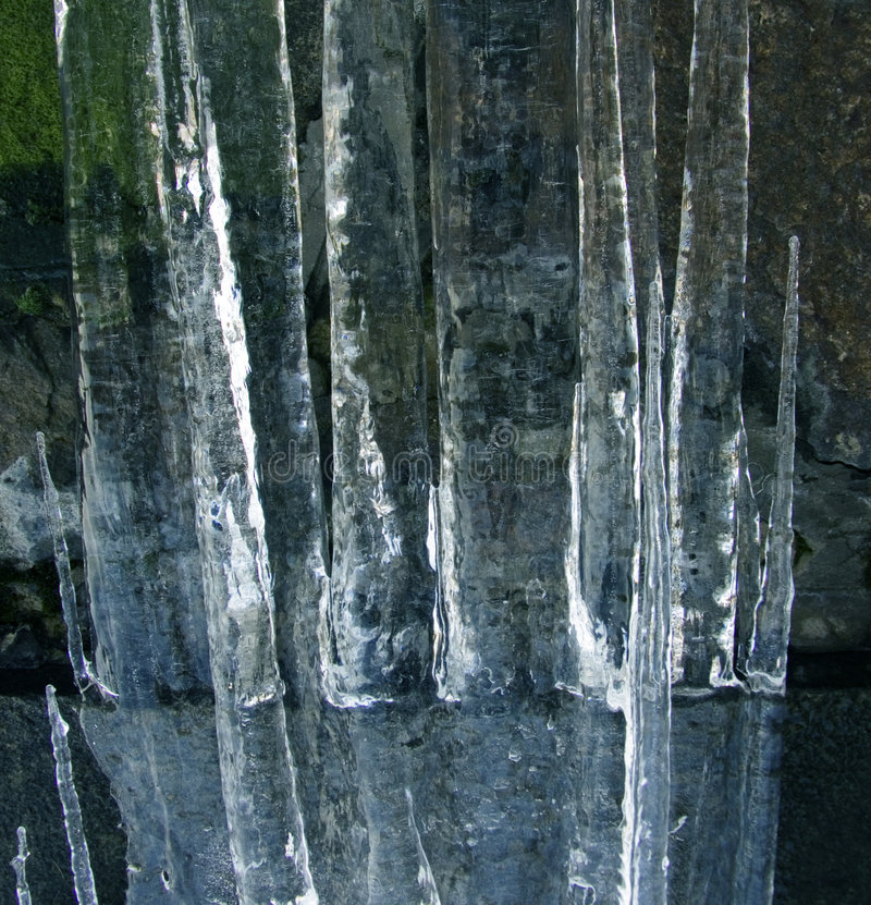 Icicles and their reflection stock photo