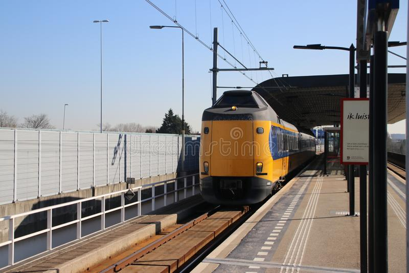 ICM intercity train type koploper along the platform at railway station Voorburg in the Netherlands. ICM intercity train type koploper along the platform at royalty free stock photography