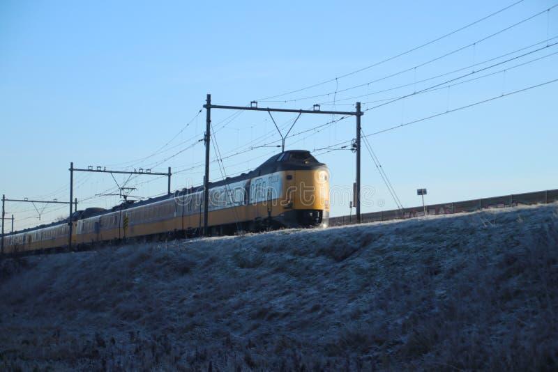 ICM koploper intercity train between snowy side stock image