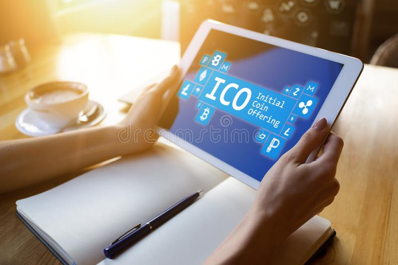 ICO - initial coin offering. Cryptocurrency, Blockchain. Fintech, modern financial technology concept. ICO - initial coin offering. Cryptocurrency, Blockchain stock photo