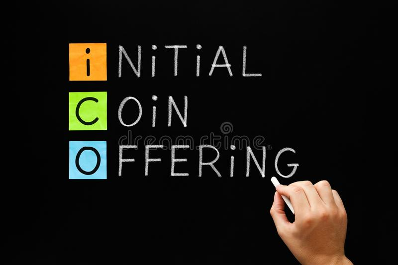 ICO - Initial Coin Offering. Hand writing ICO - Initial Coin Offering with white chalk on blackboard stock images