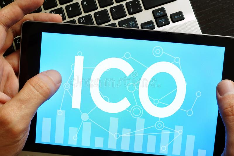 ICO Initial Coin Offering. ICO Initial Coin Offering on a screen of tablet royalty free stock photography