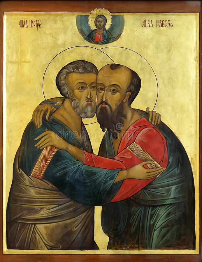Icon of Apostles Peter and Paul. Icon of saint Apostles Paul and Peter on mahogany and gold stock image