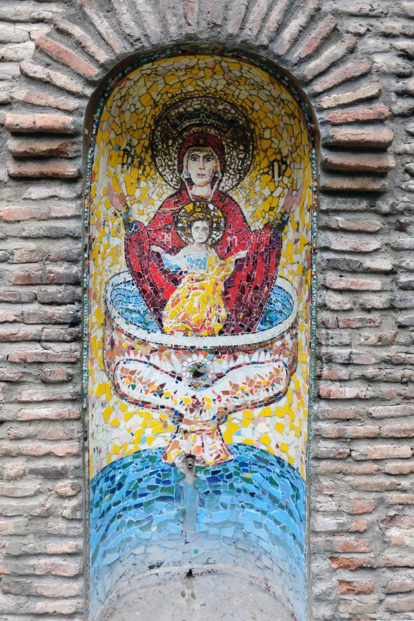 Icon of the Mother of God Undeclared Bowl on a brick wall. royalty free stock photography