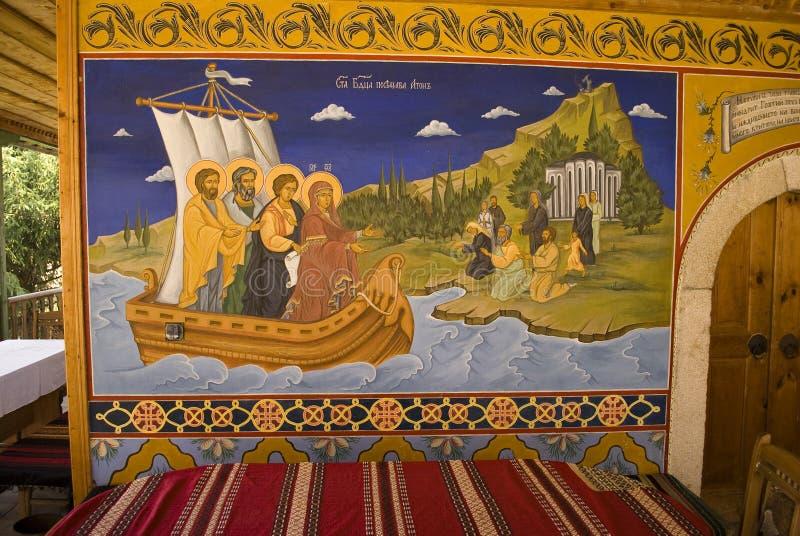 Icon paintings in monastery interior. Iconography painted icons with saints on monastery wall ? Preobrajenski Monastery near Veliko Turnovo Bulgaria (built in royalty free illustration