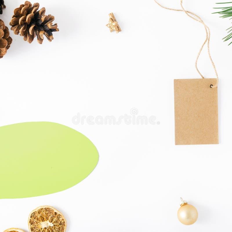 Icon thoughts, Christmas tree, price tag, cones, orange, Christmas balls. Flat lay christmas composition. Icon thoughts with branch of Christmas tree, price tag stock photo