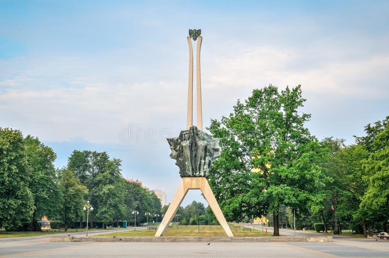 Icon of Tychy city in Poland. TYCHY, POLAND - JULY 7, 2017: Icon of Tychy city in Poland. Monument of struggle and work in a city park stock image