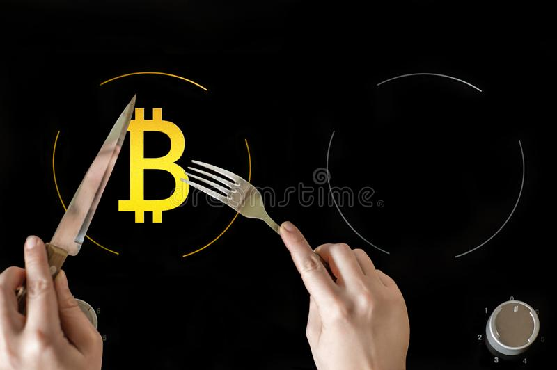 A icon of virtual electronic gold money bitcoin on the electric plate hob. The concept of finance and food. The concept of high quality food in a elite stock photos