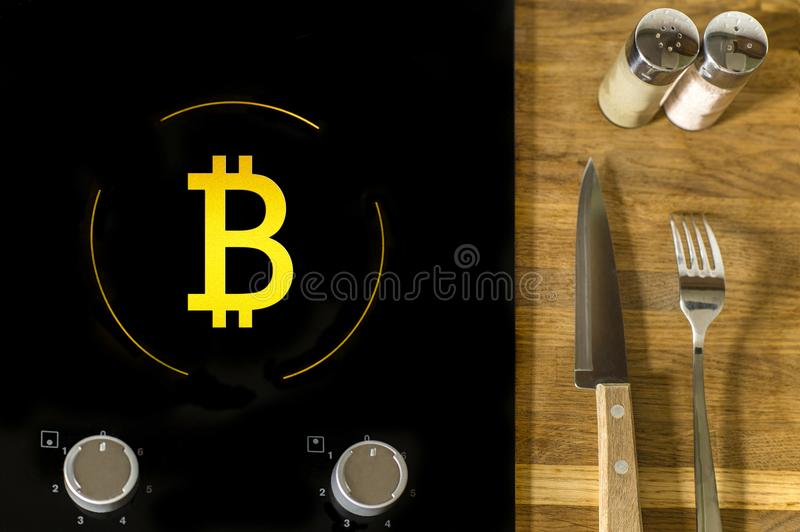 A icon of virtual electronic gold money bitcoin on the electric plate hob. The concept of finance and food. The concept of high quality food in a elite stock images