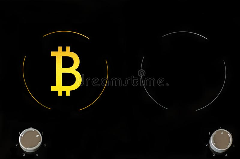 A icon of virtual electronic gold money bitcoin on the electric plate hob. The concept of finance and food. The concept of high quality food in a elite royalty free stock photography