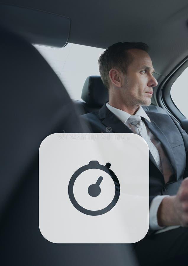 Icona dell'orologio contro l'uomo nell'automobile fotografia stock libera da diritti