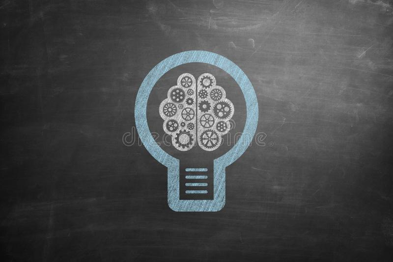 Icona della lampadina sulla lavagna immagine stock libera da diritti