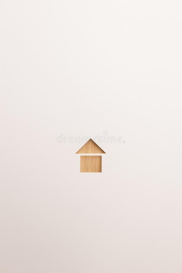 Icona di base strutturata di legno della casa su fondo bianco fotografia stock libera da diritti