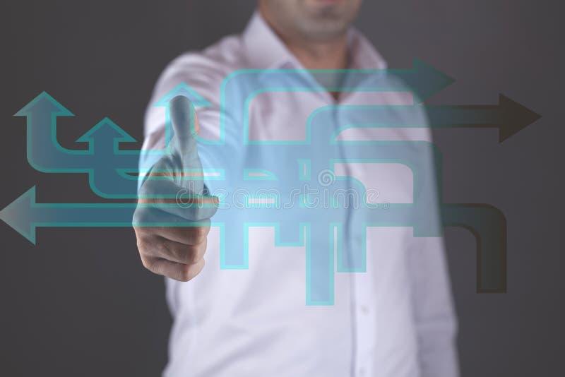Icone della strada della mano del giovane in schermo fotografie stock