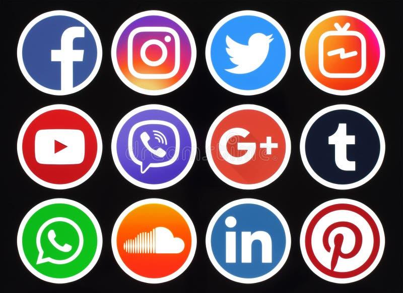 Icone sociali di media del cerchio popolare con l'orlo bianco su backgr nero