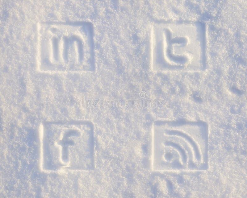 Icone sociali di media in neve fotografie stock