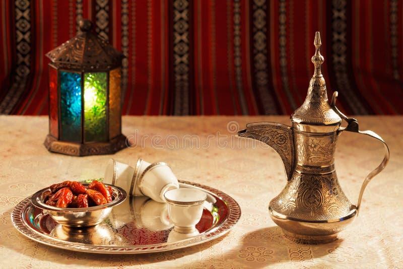 Iconic Abrian fabric tea and dates symbolise Arabian hospitality stock photos