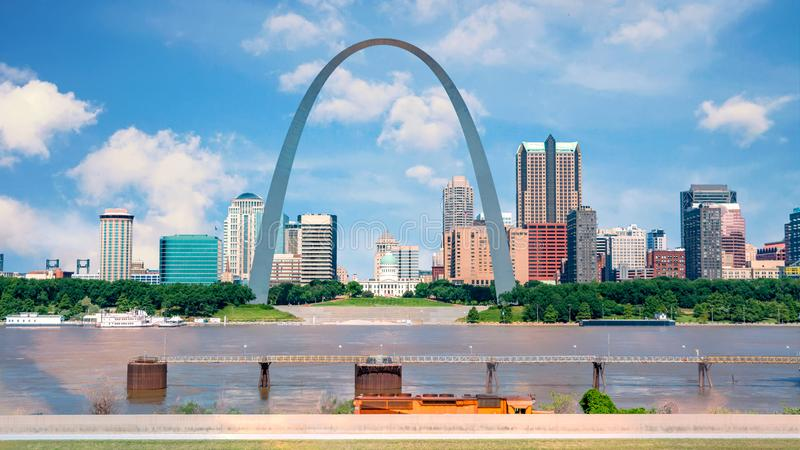 St Louis with Mississippi river and famous arch. Iconic arch to the west with St. Louis an capital building royalty free stock photos